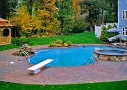 Concrete pavers, Symmetry pattern,. Brick coping, Fieldstone hot tub, Fieldstone steps, landscaping