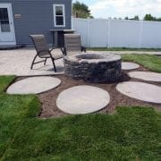 Fire pit with concrete pad for seating