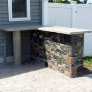 Stone bar with concrete counter